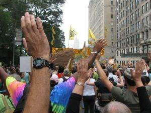 Climate March Hands Up
