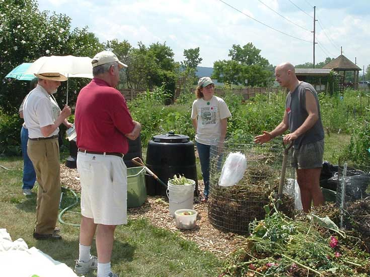 "Master Composter volunteers from Tompkins County Cornell Cooperative Extension provide free ""Compost with Confidence"" workshops at the Ithaca Community Gardens"